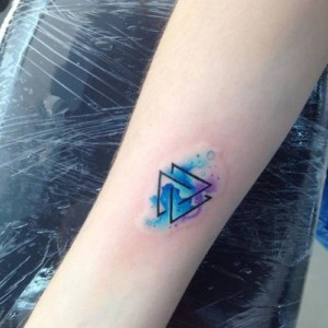 Small watercolor triquetra tattoo for women